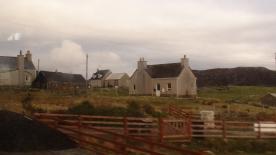 Small squarish homes in a farm landscape