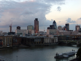 London riverscape with tall buildings including the Gherkin in the distance