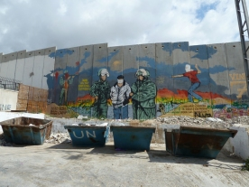 The separation wall painted with a mural of two army officers escorting a blindfolded prisoner
