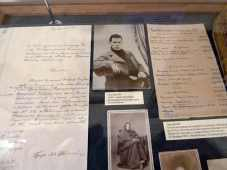 Display of letters and photographs, one showing Tolstoy as a young man