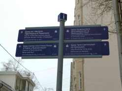 A sign post with directions to four different churches nearby