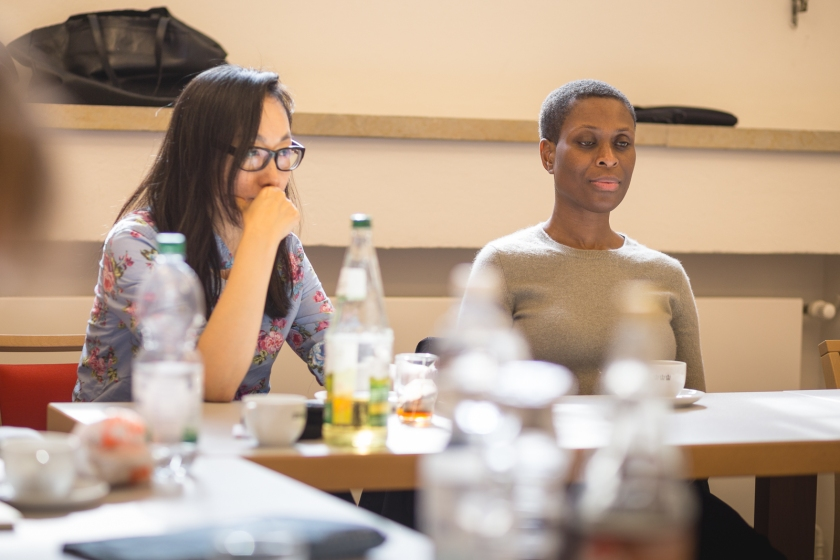 Two women sit at a table for script reading